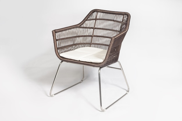 Brown rattan modern outdoor chair with metal legs isolated on white background