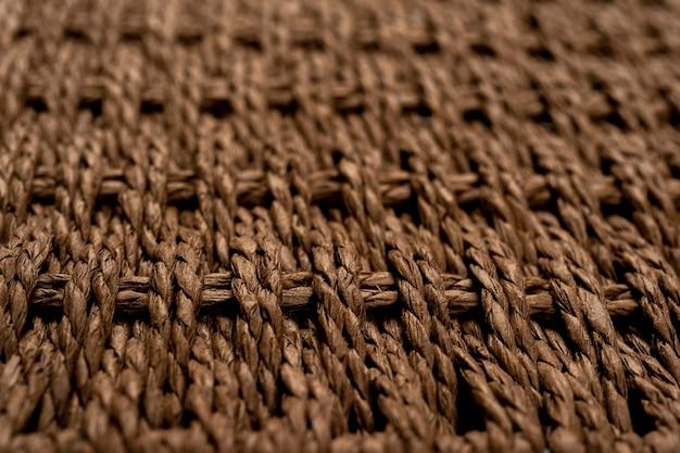高解像度の背景の茶色の籐のテクスチャ合成繊維のテクスチャの背景をクローズアップ