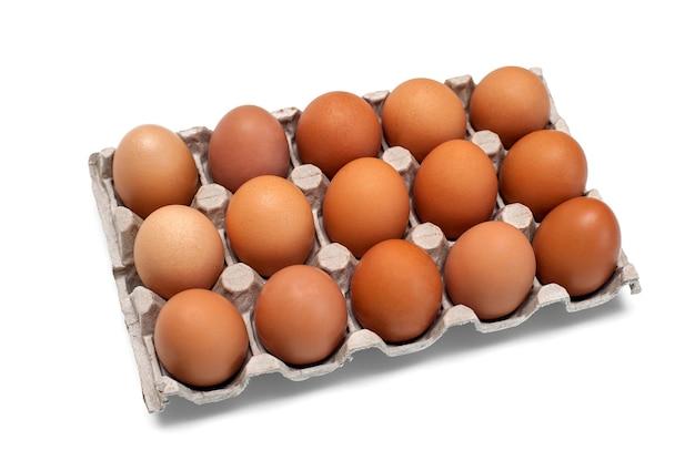 계란에 대 한 골 판지 상자에 갈색 원시 닭고기 달걀. 음식 배경입니다.