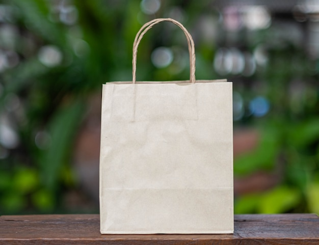 Brown recyclable paper shopping bag placed on a wooden table