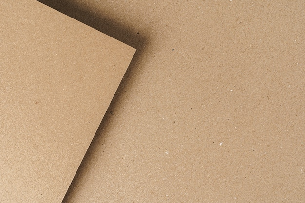 Brown recycled carton paper sheets close up. business concept