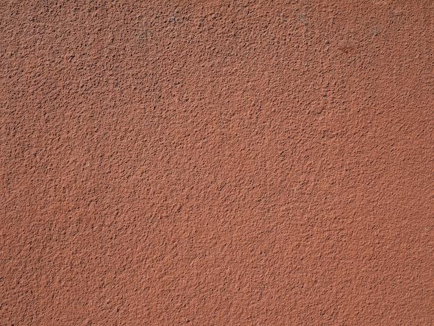 Коричнево-красная штукатурка стены фон