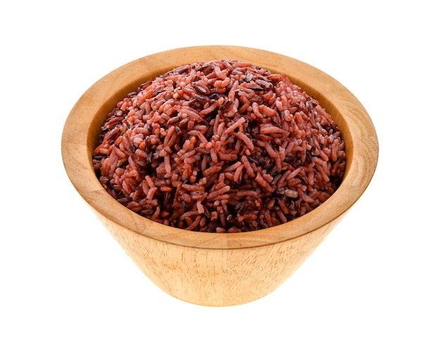 Brown rice in a bowl on white background
