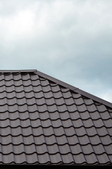 Brown roof tiles or shingles on house as background image