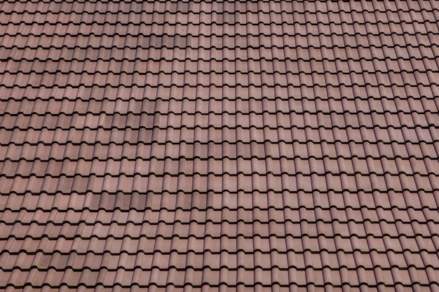 Brown roof with metal tile on blue sky