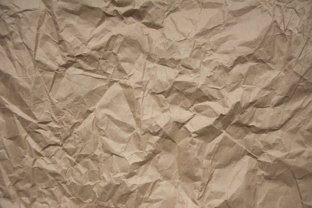 Brown rough crumpled recycled paper texture brown