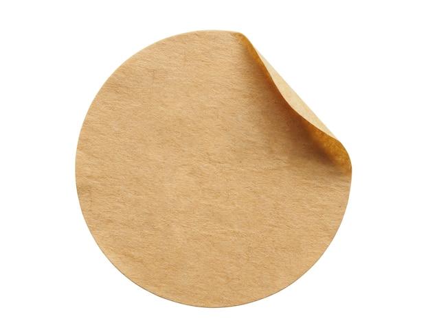 白い背景で隔離の茶色の丸い紙のステッカーラベル