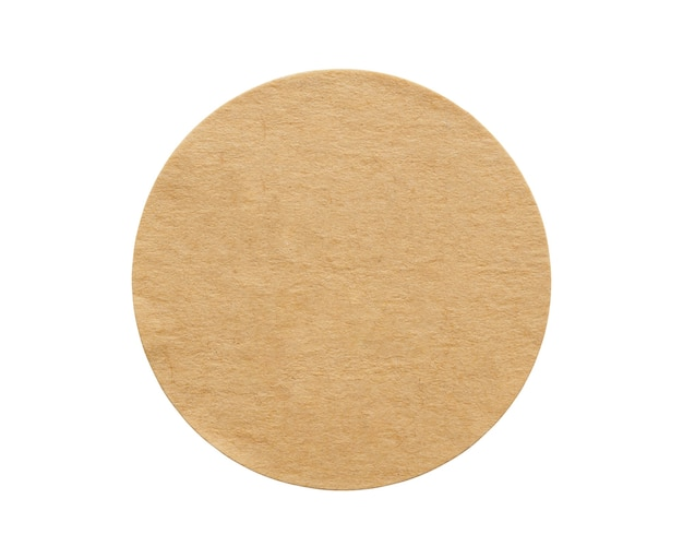 Brown round paper sticker label isolated on white background