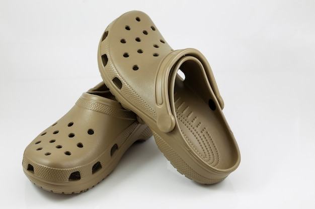 Brown rubber sandals on a white background.
