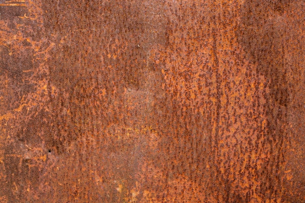 Brown rusted and scratched metal surface texture