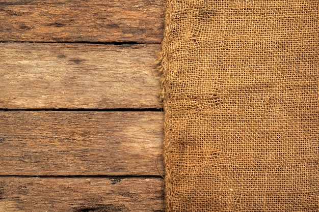 Brown sackcloth placed on a wooden table.