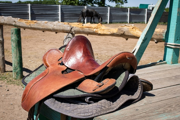 Brown saddle lying on wooden table