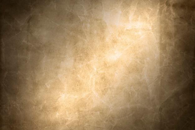 Sfondo di carta ruvida graffiata marrone