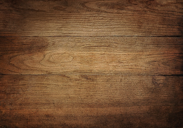 Brown scratched wooden cutting board.