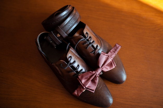 Brown shoes and a tie