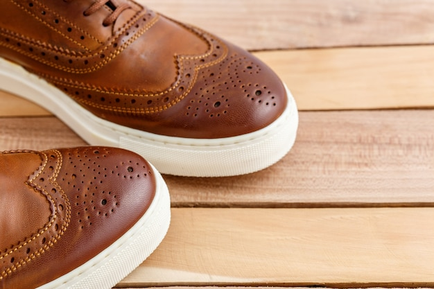 Brown shoes on a wooden floor