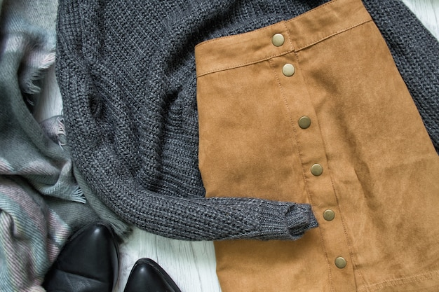 Brown skirt and gray sweater. fashionable concept