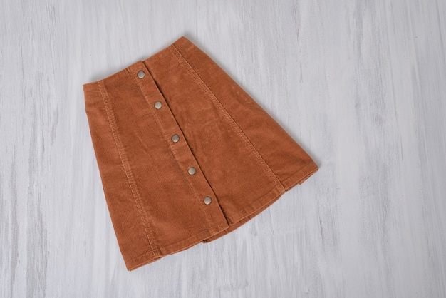 Brown skirt on a wooden surface