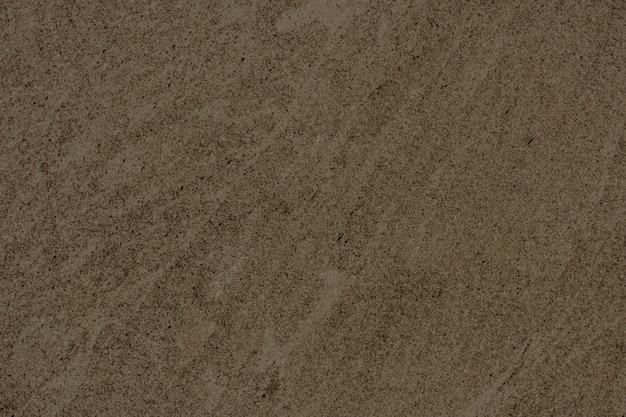 茶色の滑らかなコンクリートの壁の背景