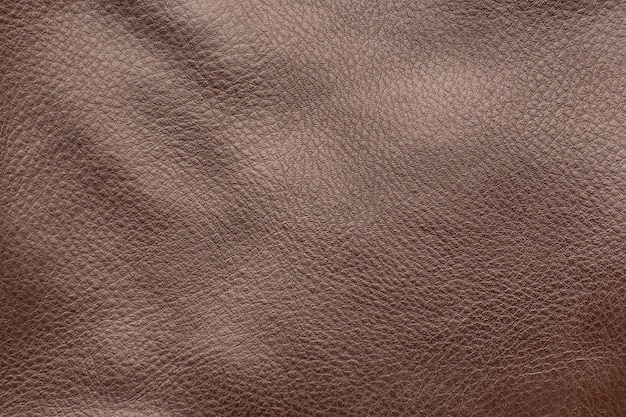 Brown smooth leather surface. close-up. texture background.