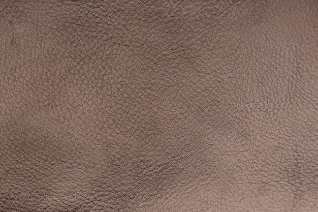 Brown smooth leather surface. texture background. close-up.