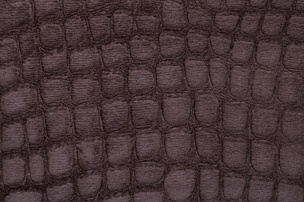 Brown soft upholstery textile material, closeup. fabric with pattern