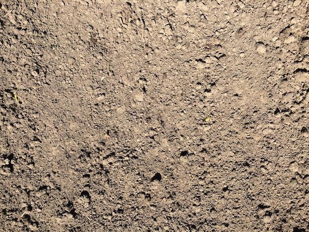 Коричневый фон текстуры почвы вид сверху поверхности земли