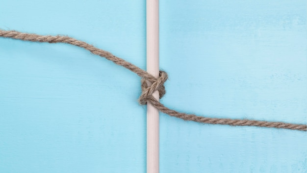 Brown solid rope surrounding a bar