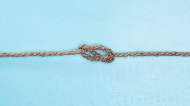 Brown solid rope with a knot