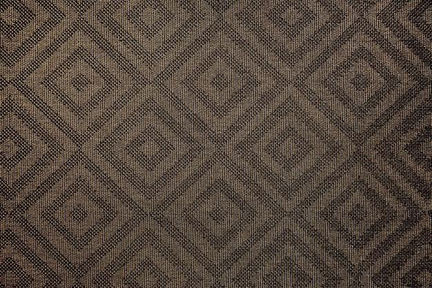 茶色の正方形のパターン生地の織り目加工の背景