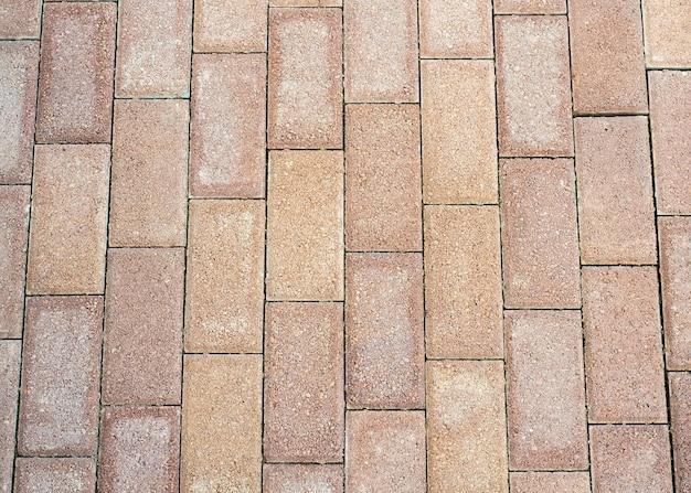 茶色の石畳のテクスチャをクローズアップ