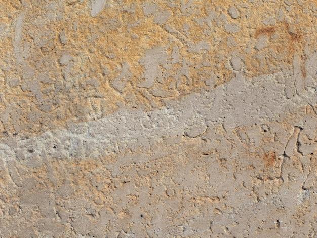 Коричневая каменная стена фон