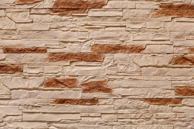 Brown stone wall made with blocks . pattern of slate wall texture and background