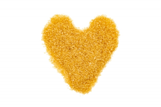 Brown sugar, heart-shaped, isolated, close up, macro, top view.
