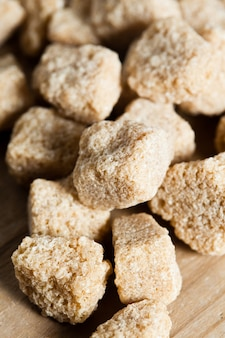Brown sugar, natural cubes closeup