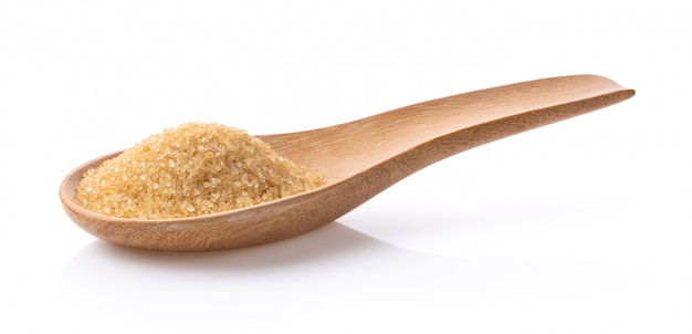 Brown sugar in wood spoon on white background