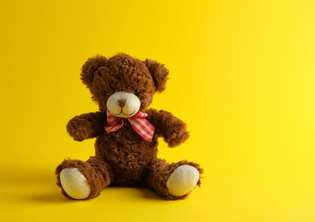Brown teddy bear sitting
