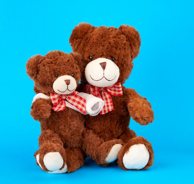 Brown teddy bear with rewound white bandage
