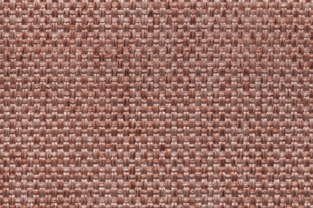 Brown textile background with checkered design, closeup.