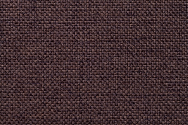 Brown textile background with checkered pattern