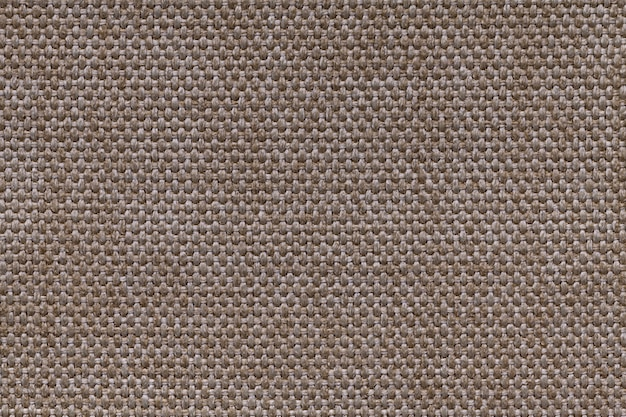 Brown textile background with checkered patterno.