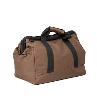 흰색 배경에 고립 된 손잡이와 갈색 섬유 여행 가방