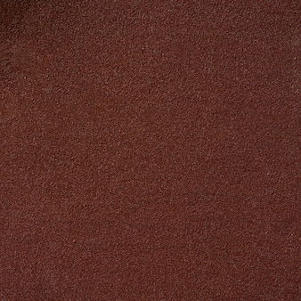 The brown texture of sandpaper for paper background.