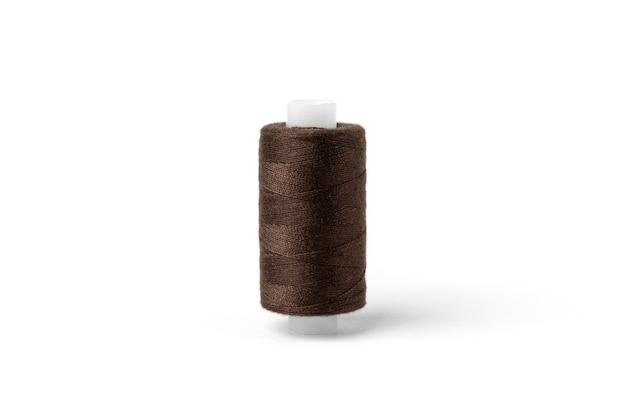 Brown threads on white background.