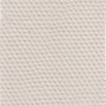 Brown toilet paper texture. recycled lavatory paper pattern. close-up.