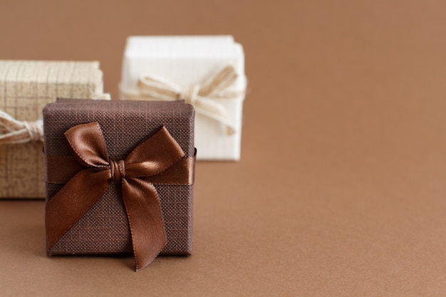 Brown tones gift boxes on a brown background close up