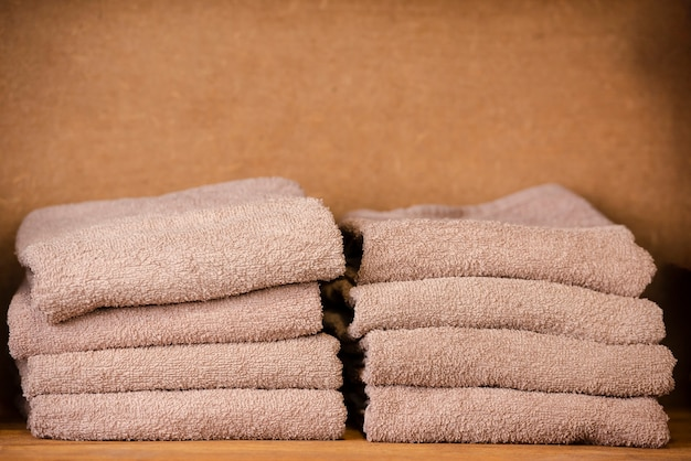 Brown towels sitting on the shelf