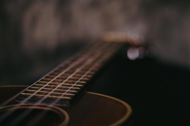 Brown ukulele guitar portrait on texture wall plaster
