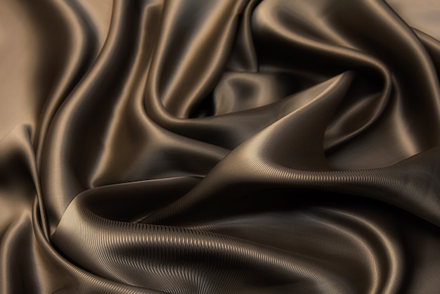 Текстура коричневой вискозной ткани. фон, узор.