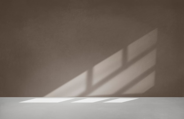 Brown wall in an empty room with concrete floor